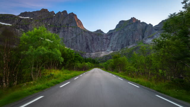 Flight over road in arctic mountains, Lofoten Islands, Norway