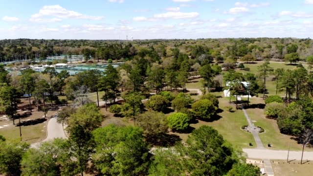 a flight over the park and lake (landen lake) in mobile, alabama. - landen stock videos and b-roll footage