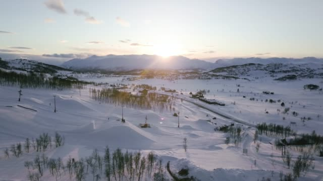 Flight over Vierli ski resort, viewing an beautiful sunset.