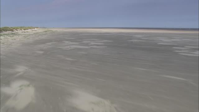 flight over wide sands of spiekeroog island - north frisian islands stock videos & royalty-free footage