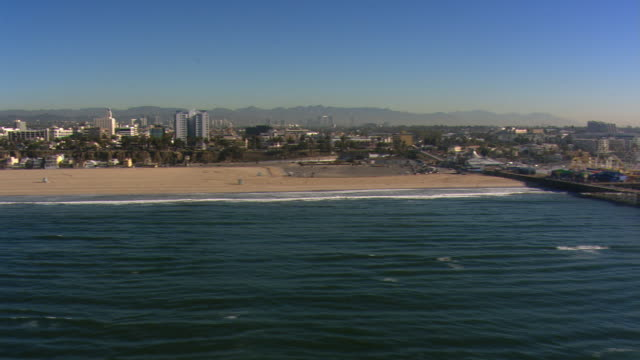 flight paralleling beach to santa monica pier. shot in 2008. - santa monica pier stock videos & royalty-free footage