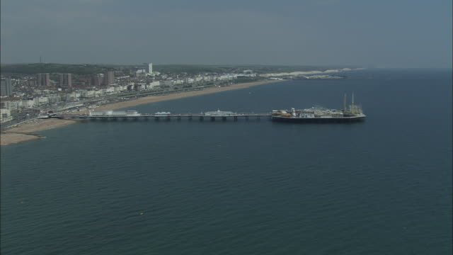 flight past brighton pier - brighton england stock videos & royalty-free footage
