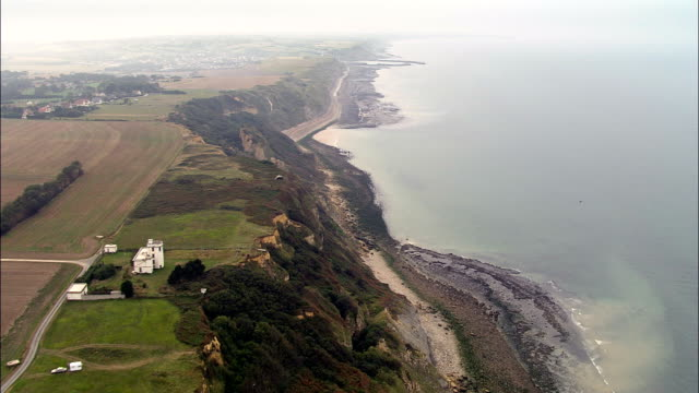 flight past cliffs and bunker  - aerial view - lower normandy, calvados, arrondissement de bayeux, france - d day stock videos and b-roll footage