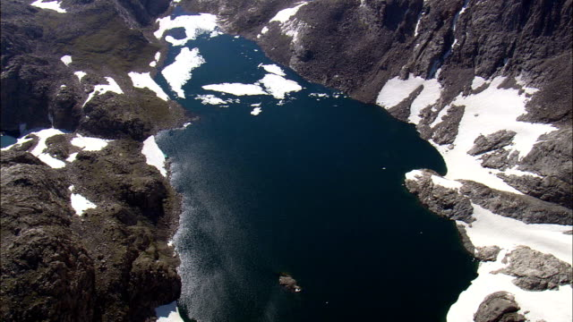 flight past klondike lake with sun reflection  - aerial view - wyoming,  fremont county,  helicopter filming,  aerial video,  cineflex,  establishing shot,  united states - klondike river stock videos and b-roll footage