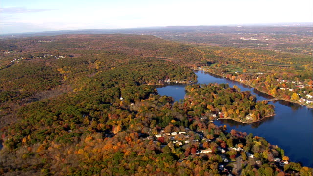 Flight Past theriaults Ice Pond And Hitchcock Lake  - Aerial View - Connecticut,  New Haven County,  United States