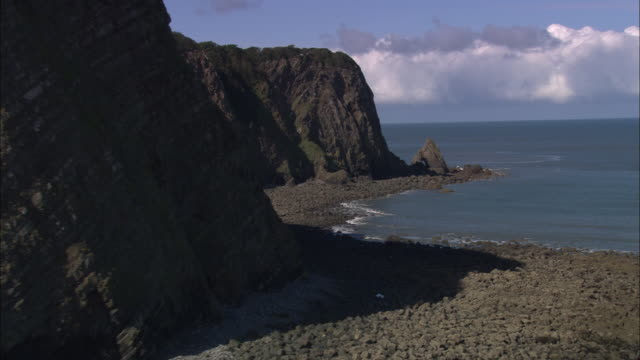 flight round eldern point (to west of clovelley) - outcrop stock videos and b-roll footage