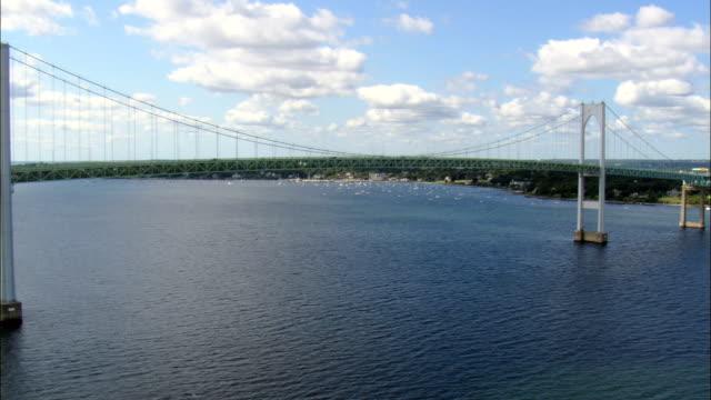flight round newport bridge  - aerial view - rhode island, newport county, united states - musical instrument bridge stock videos & royalty-free footage