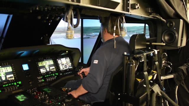 flight simulator service engineer conducts regular routine maintenance of uh60 blackhawk helicopter simulator in illesheim us army garrison ansbach... - air vehicle stock videos & royalty-free footage