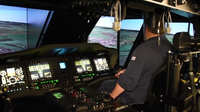 flight simulator service engineer conducts regular routine maintenance of uh60 blackhawk helicopter simulator in illesheim us army garrison ansbach... - black hawk helicopter stock videos and b-roll footage