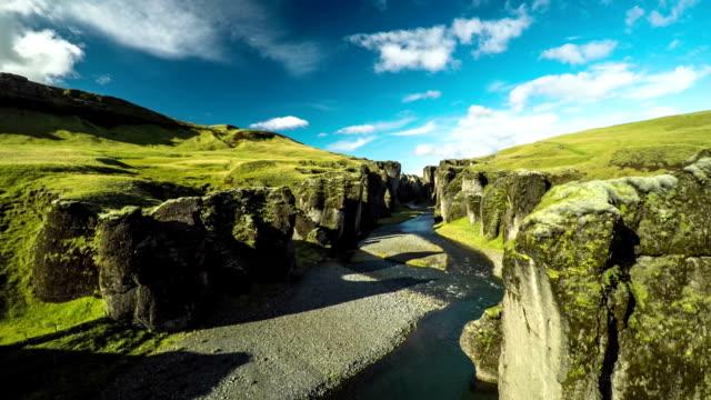 flight through fjadrargljufur canyon in iceland - tectonic stock videos & royalty-free footage
