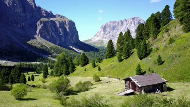 flight through meadows and valley of passo gardena toward selva wolfenstein, dolomites, south tyrol, italy, europe - 50 seconds or greater stock videos & royalty-free footage