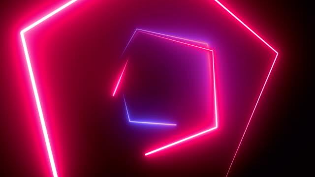 ネオントンネルを通って飛行、移動ファッションの表彰台、抽象的な背景、回転フレーム、仮想現実、抽象的なネオン六角形形状の背景マルチカラー4kループ可能。 - 発光ダイオード点の映像素材/bロール