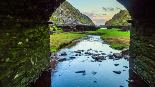 Flight through stone bridge at Gap of Dunloe in Ireland