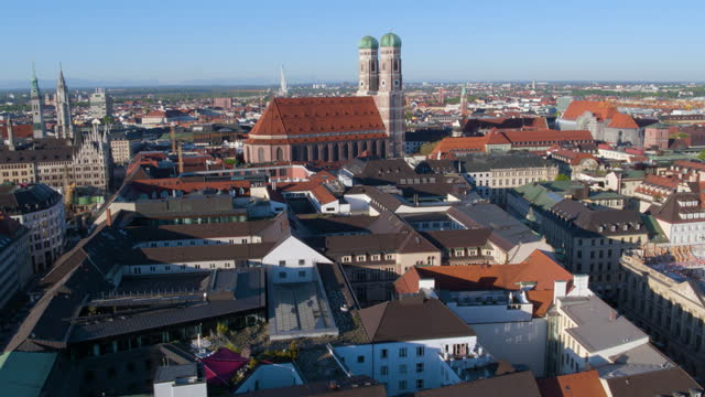 flight through theatiner church towers toward church of our lady - rathaus stock videos & royalty-free footage