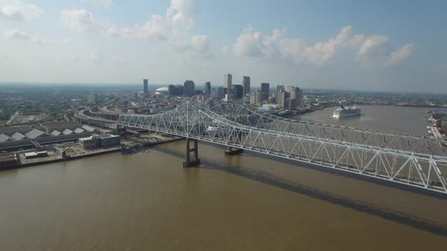 flight to new orleans city close to bridge - drone aerial 4k mississippi river bridge and barge 1of14, everglades, gulf delta, new orleans, st louis, with cruise boats sailing and wildlife 4k transportation - new orleans stock-videos und b-roll-filmmaterial