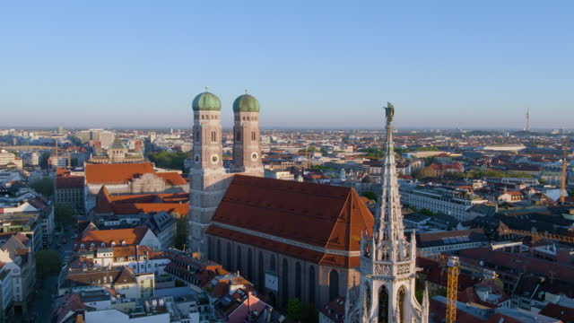 flight toward church of our lady with townhall tower in foreground - rathaus stock videos & royalty-free footage