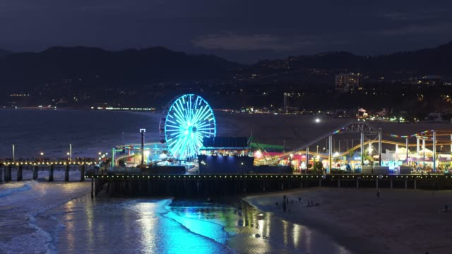 flight towards santa monica pier at night - santa monica pier stock videos & royalty-free footage