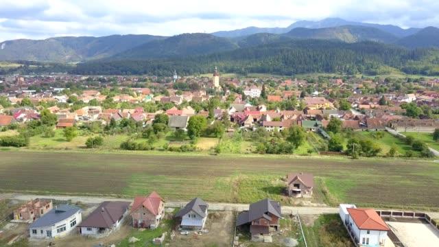 flight towards the fortified church in cristian, brasov - siebenbürgen stock-videos und b-roll-filmmaterial