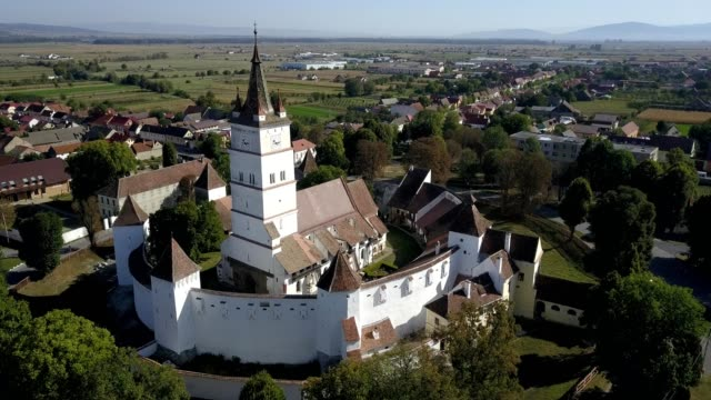 flight towards the fortified church in harman - transilvania video stock e b–roll