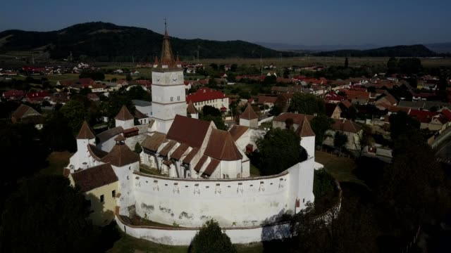 flight towards the fortified church in harman - transylvania stock videos & royalty-free footage