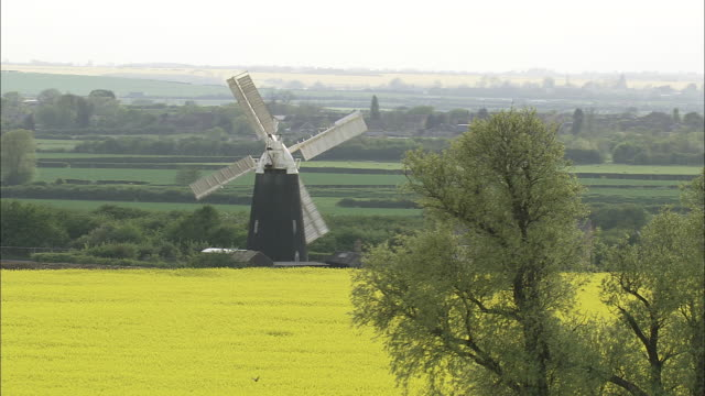 flight towards working windmill - mill stock videos & royalty-free footage