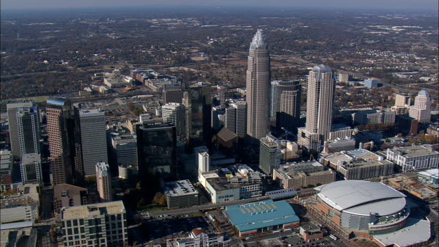 flight tracking past charlotte  - aerial view - north carolina,  mecklenburg county,  united states - charlotte north carolina stock videos & royalty-free footage