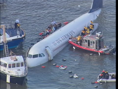 flight us airways 1549 in the hudson river is being rescued by ferry boats and rescue boats. - river hudson stock videos & royalty-free footage