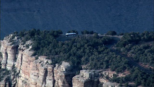 Flight With Reveal Of Grand Canyon From Coach On Canyon Edge  - Aerial View - Arizona,  Coconino County,  United States