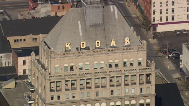 flight with reveal of kodak building - headquarters stock videos & royalty-free footage