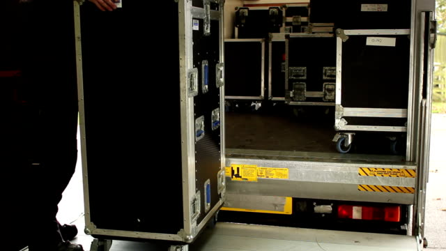 flightcases being loaded into a truck - flight case stock videos and b-roll footage