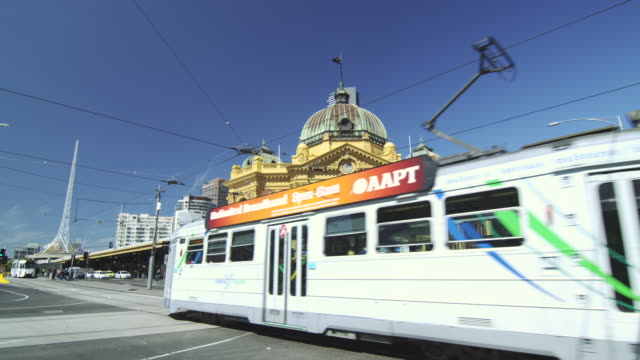 Flinders Street Station with Tram going along Swanston Street, Melbourne, Victoria, Australia