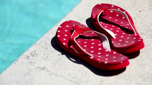 flip flops by the side of swimming pool - polka dot stock videos and b-roll footage