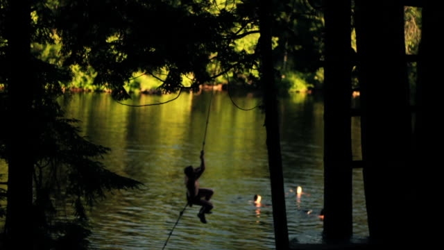 flip off of a rope swing - rope swing stock videos & royalty-free footage
