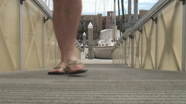 hd: flip-flops, thongs, jandals on boat dock - coming - flip flop stock videos and b-roll footage