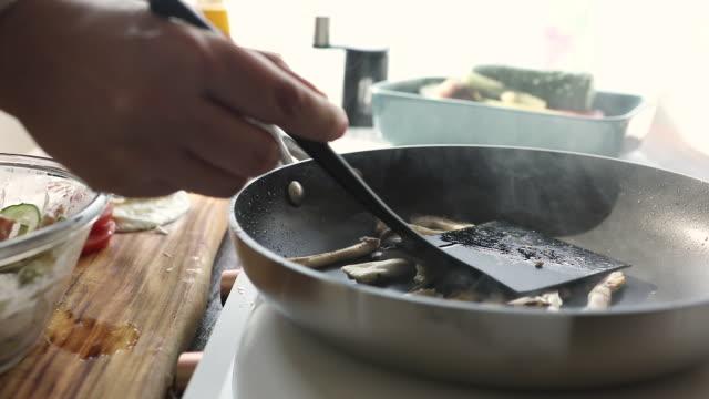 flipping oyster mushroom by a fritter tender - oyster mushroom stock videos & royalty-free footage