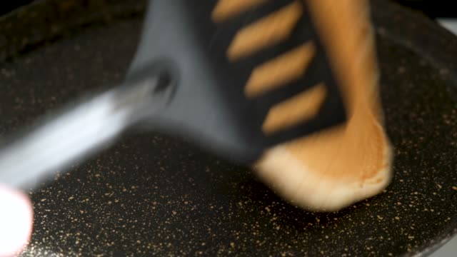 flipping pancake on cooking pan - throwing stock videos & royalty-free footage
