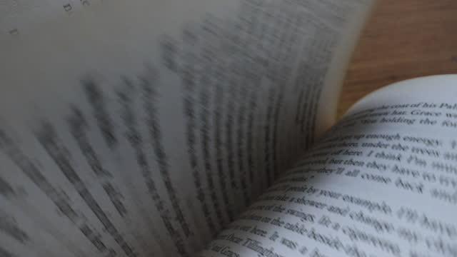 flipping through pages of a hardcover book in slow motion - author stock videos & royalty-free footage