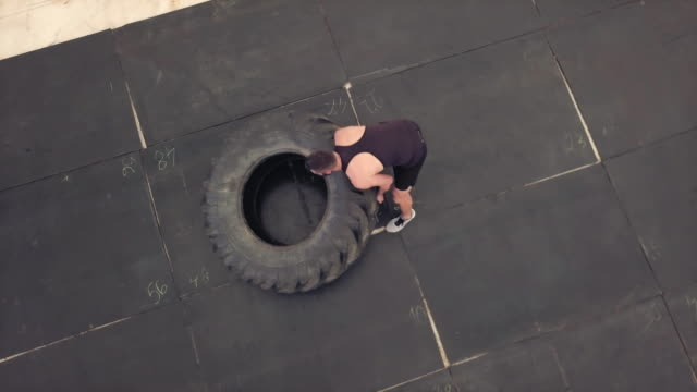 Flipping tractor tire, aerial view