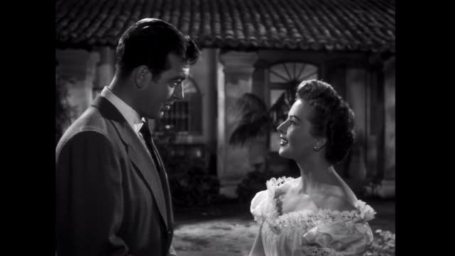 stockvideo's en b-roll-footage met 1952 a flirtation between inn guests is observed by a disapproving man - 1952