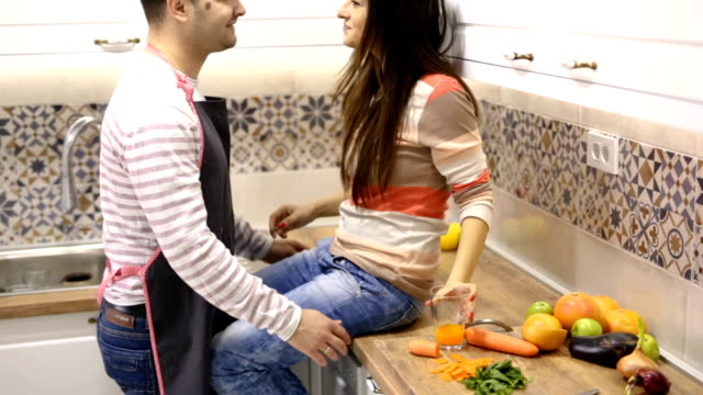 flirting in kitchen - sexual issues stock videos & royalty-free footage