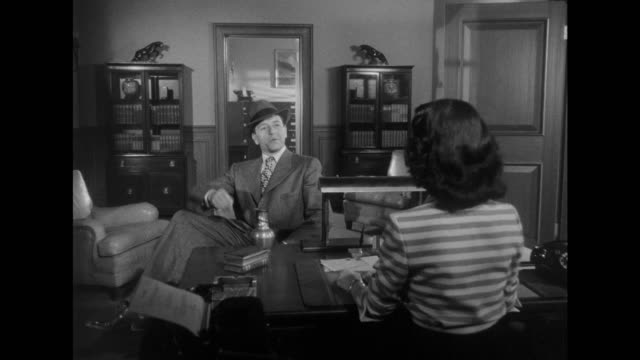 1948 Flirting man (Paul Henreid) talks psychoanalysis with cynical woman (Joan Bennett)