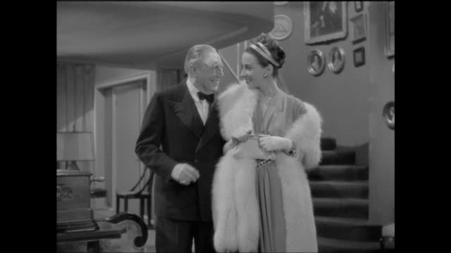 1946 Flirting older man shows young woman (Patricia Morison) music box collection