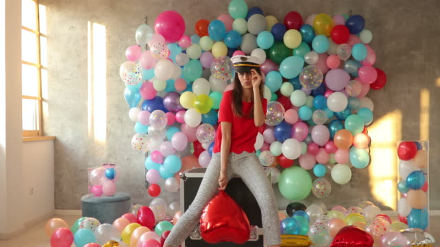 flirting woman with sailor hat in room with balloons - sailor hat stock videos & royalty-free footage