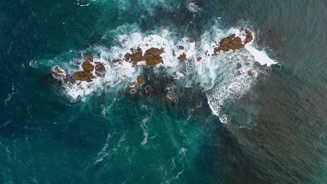 fliying over karekare beach in west auckland, new zealand - seascape stock videos & royalty-free footage