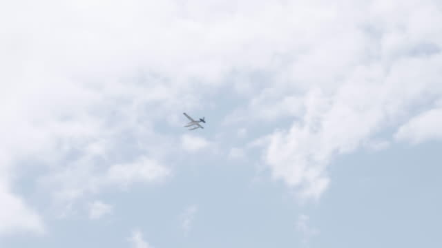 UHD 4K SLOMO: Float airplanes flying in and out of a lake on a summer afternoon
