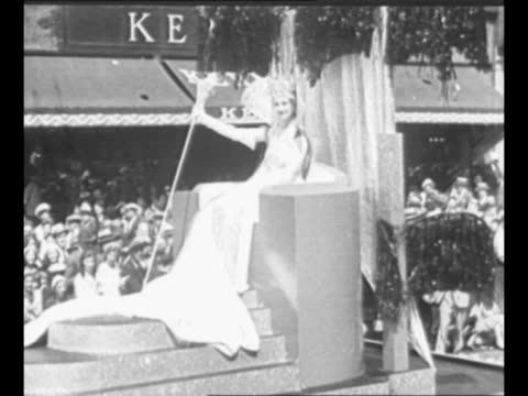float carrying women moves past during opening parade of the 1933 century of progress exposition the 1933 world's fair in chicago il / queen of the... - chicago world's fair stock videos & royalty-free footage