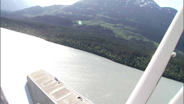 a float plane flies over a fjord in the alaskan wilderness. - non urban scene stock videos & royalty-free footage