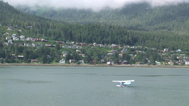 ws, ha, float plane moving towards coastline, juneau, alaska, usa - juneau stock videos and b-roll footage