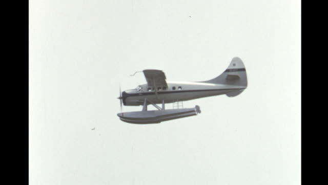 1952 HOME MOVIE Floater plane taking off at the Canadian National Exhibition air show / Toronto, Canada