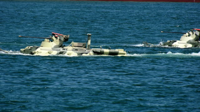 floating armored personnel carriers in the amphibious assault - amphibious vehicle stock videos & royalty-free footage